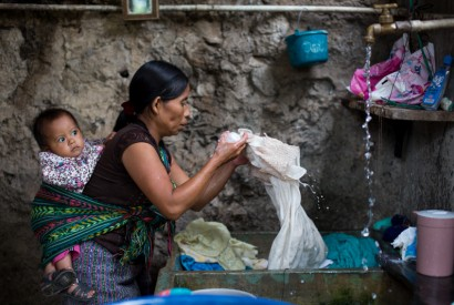 Catarina Pascual Jimenez visits families in her neighborhood asking for odd jobs such as washing clothes and menial labor in order to earn a few Quatzales (Guatemalen currency). Joseph Molieri/Bread for the World.
