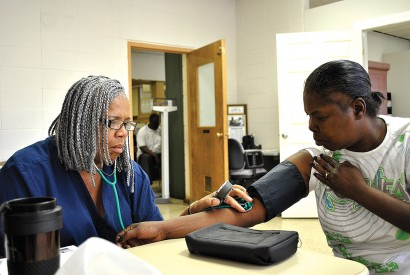 Julia Means, a parish nurse on staff at Columbia St. Mary's Hospital, brings health services to churches and other locations in underserved communities of Milwaukee, Wis.