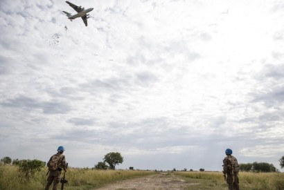 UN peace keepers provide security as the World Food Program drops food in Bentiu, South Sudan in 2015. Photo courtesy of the World Food Programme.