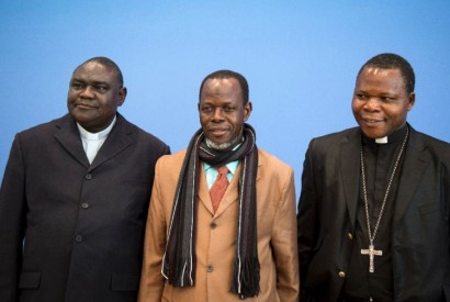 From left to right, Pastor Nicolas Guerekoyame Gbangou, Imam Oumar Kobine Layama, and Archbishop Dieudonne Nzapalainga. AFP Photo/Johannes Eisele.