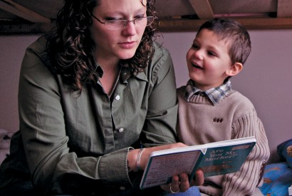 Heather Rude-Turner, reading to her son Isaac, depends on EITC (earned income tax credit) to help support her family. Laura Elizabeth Pohl/Bread for the World.