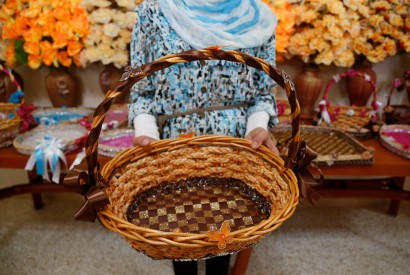 A young Syrian refugee girl in Lebanon shows a basket that she learn how to make and decorate. Russell Watkins/UK Department for International Development via Wikimedia Commons.