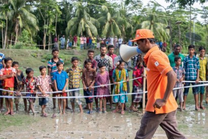 """""""I volunteer because I can save people's lives,"""" said Aslam Hossain during a July 2019 cyclone simulation drill in South Khali. Brad Zerivitz/American Red Cross"""