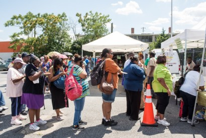 Washington D.C. residents participate in an incentive program that makes produce at farmer's markets more affordable for low-income residents as part of the Affordable Care Act. Joseph Molieri/Bread for the World.
