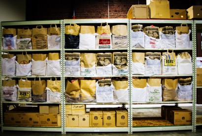 """Bags of nonperishable food items line the warehouse shelves of the Lancaster County Council of Church's food pantry also known as the """"Food Hub."""" Joseph Terranova for Bread for the World."""