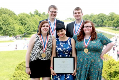Maria Rose Belding (bottom center) poses with the rest of the MEANS Database team at the Lincoln Memorial after receiving The President's Volunteer Service Award. Photo Courtesy of Matt Waskiewiczs.