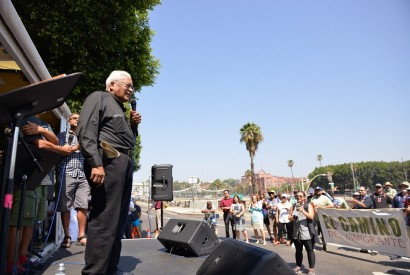 "Rev. James Lawson speaking at the ""El Camino del Inmigrante"" (the Path of the Immigrant) rally in front of a detention center in Los Angeles, Calif. last summer."