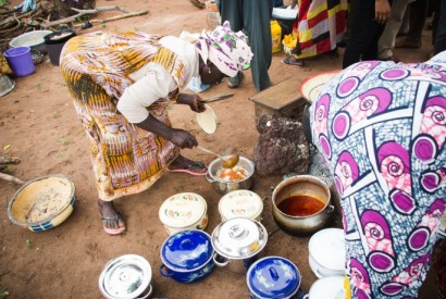Women prepare a highly nutritious meal from the orange-fleshed sweet potato, a vitamin A-rich crop introduced in Northern Ghana. / USAID/Ghana