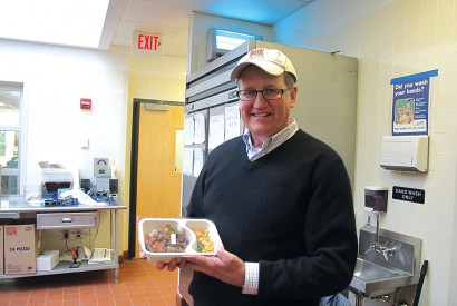 David Waters, CEO of Community Servings, displays one of the medically tailored meals prepared and delivered by the organization to chronically ill clients. Todd Post/Bread for the World.