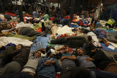 Syrian refugees resting on the floor at the Keleti railway station in Budapest, Hungary. Wikimedia Commons.