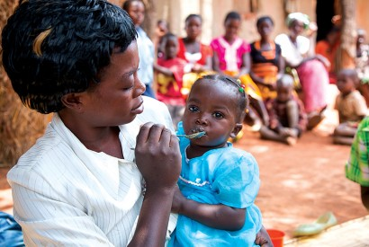Mothers in a Zambian village learn how to prepare and feed their children a nutritious porridge. Photo: Joe Molieri / Bread for the World