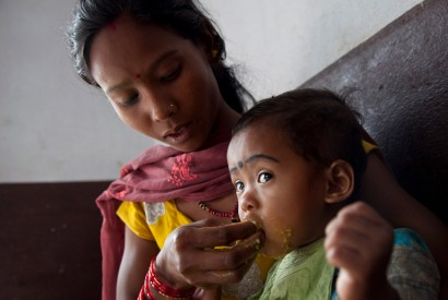Sharmila Chaudhari feeds her daughter Sanjana, 19 months, at the Nutrition Rehabilitation Home in Dhangadhi, Nepal. Photo: Laura Pohl / Bread for the World