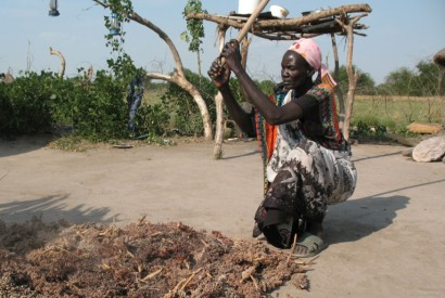 Dabora Nyibol, a returned refugee in South Sudan, prepares sorghum, a staple in her country. Photo by Stephen H. Padre/Bread for the World