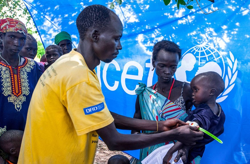 A child is screened for malnutrition at a UNICEF-supported health center in Aweil, South Sudan. Photo by UNICEF South Sudan/Sebastian Rich
