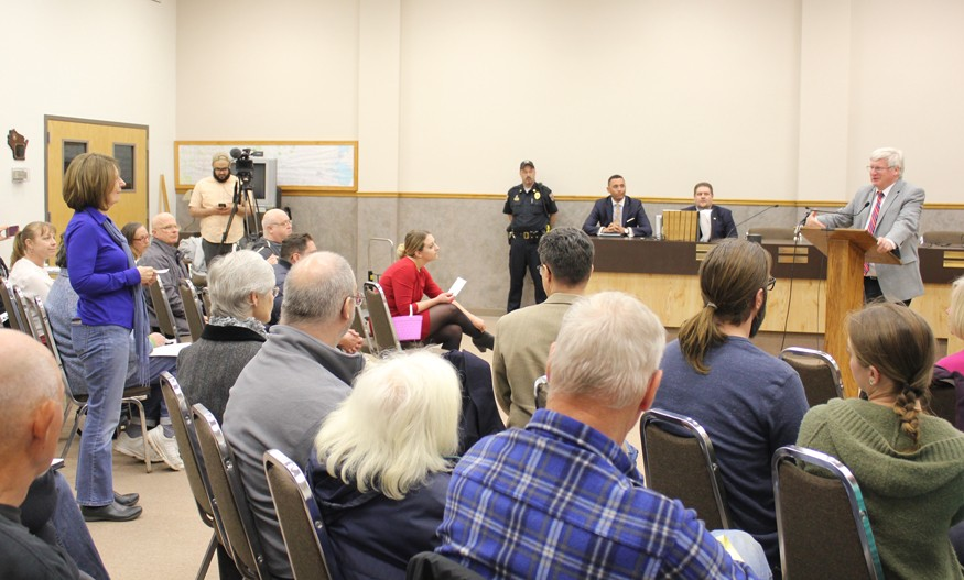 Deb Martin uses a public forum to ask Rep. Glenn Grotham to protect foreign aid funding. Photo: courtesy of Glen Grotham