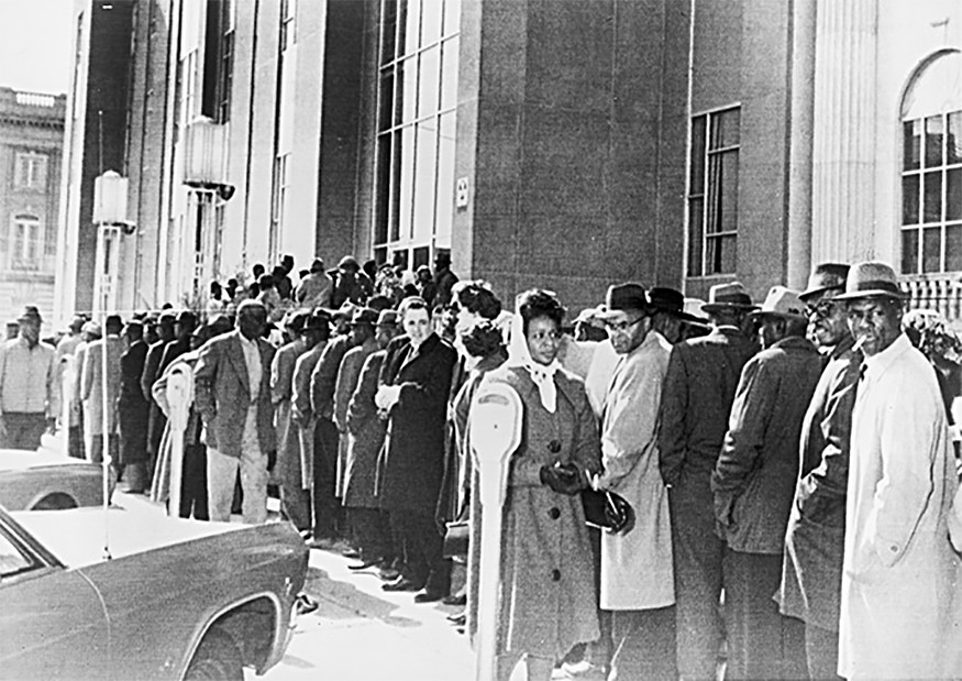 African Americans, waiting to register to vote, form a long line outside the Dallas Courthouse in Selma, Alabama, February 1965. New York World-Telegram and the Sun Newspaper Collection, Prints and Photographs Division, Library of Congress.