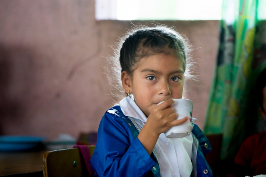 Angie Galvez sips her drink after enjoying her meal provided in rural Guatemala. USAID provides funding for school meals (Food for Education) in some of the most impoverished and malnurished areas. Photo: Joe Molieri / Bread for the World