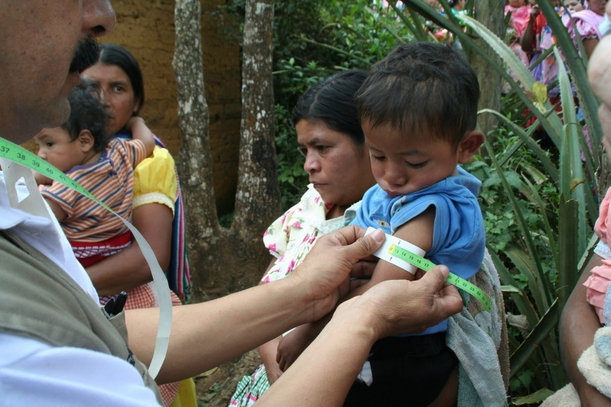 A child gets his arm circumference measured as part of the Save the Children's growth monitoring program to check for malnourishment in Chiquimula, Guatemala. Todd Post/Bread for the World Institute.