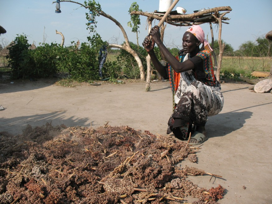 Dabora Nyibol, a returned refugee in South Sudan, prepares sorghum, a staple in her country. Bread for the World photo.