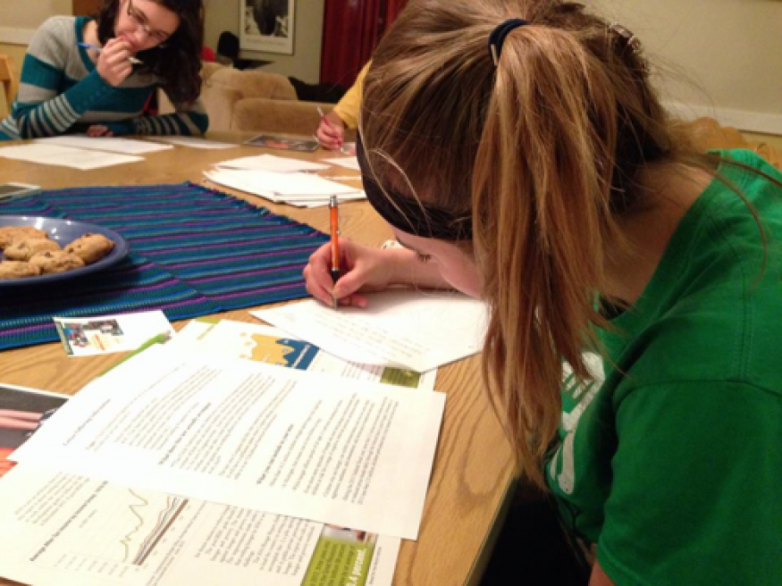 Students at Calvin College write letters to Sen. Debbie Stabenow (D-Mich). Cameron Kritikos for Bread for the World.