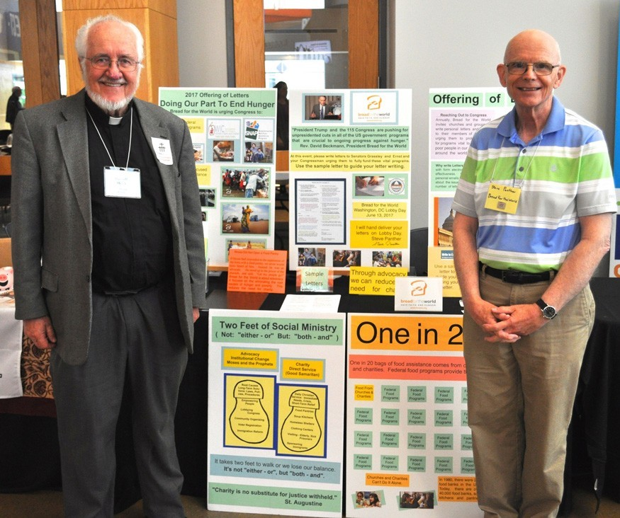 Rev. Russel Melby, left, and Stephen Panther, right, at the Southeastern Iowa Synod Assembly (ELCA) in Des Moines, Iowa.