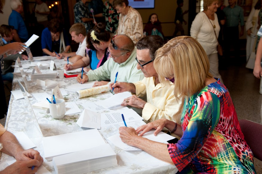 Coral Gables Congregational United Church of Christ congregants write letters to their elected officials. Lena Isely for Bread for the World.