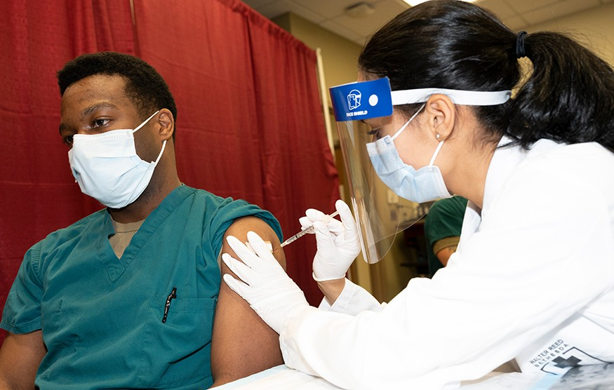 Army Cpt. Isaiah Horton, a doctor at Walter Reed National Military Medical Center, receives a COVID-19 vaccination, Walter Reed National Military Medical Center, Bethesda, Md. DoD photo by Lisa Ferdinando