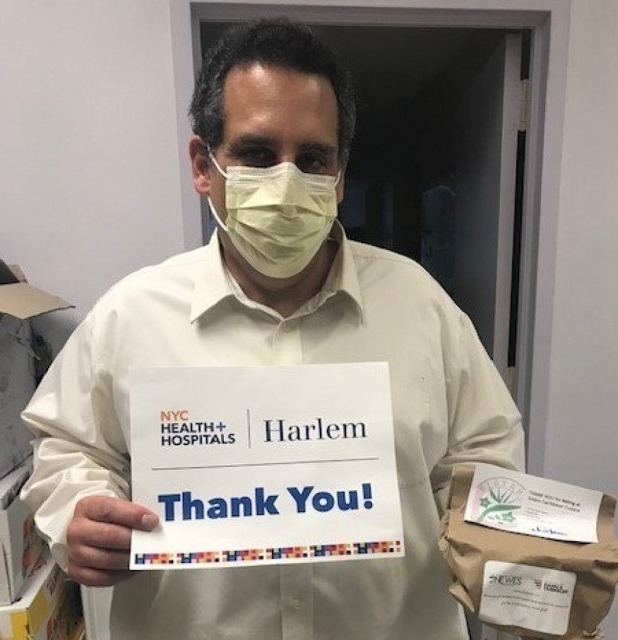 An environmental services manager at Harlem Hospital Center thanks Charitable Alumni of FAMU and Tuskegee and the Wesley Foundation for meals
