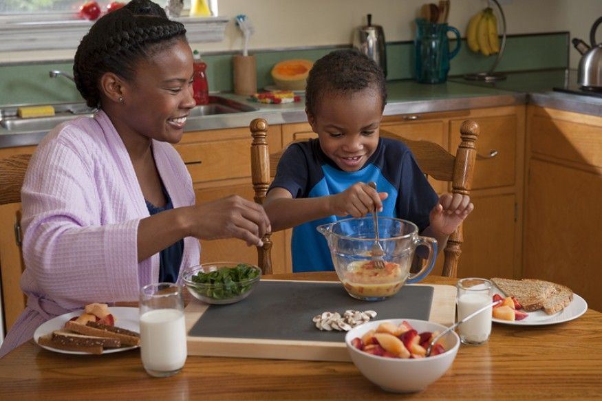 A mother and son prepare breakfast together. Photo courtesy of USDA.