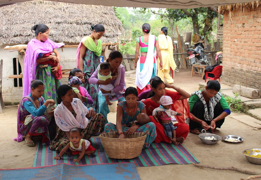 Mothers and their children attend a food demonstration conducted by Female Community Health Volunteers with the Suahaara II Program in Nepal. Kesi Marcano-Collier/Bread for the World.