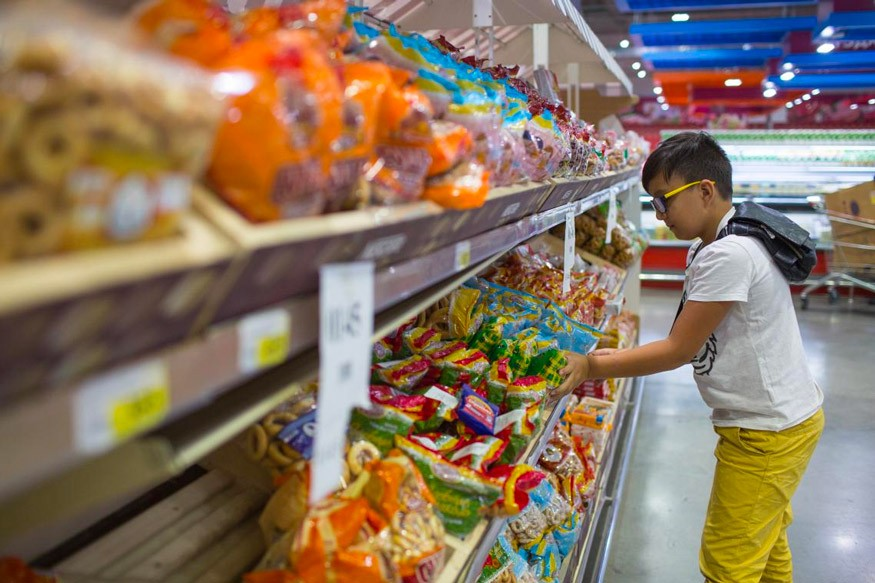 Yerzhan-Kazakhstan-Unicef.jpg (Some info about the photo) Yerzhan browses the snack section at a shop in Kazakhstan. He says his favorite sweets are the famous foreign brands. ©UNICEF/UNI209837/Karimova