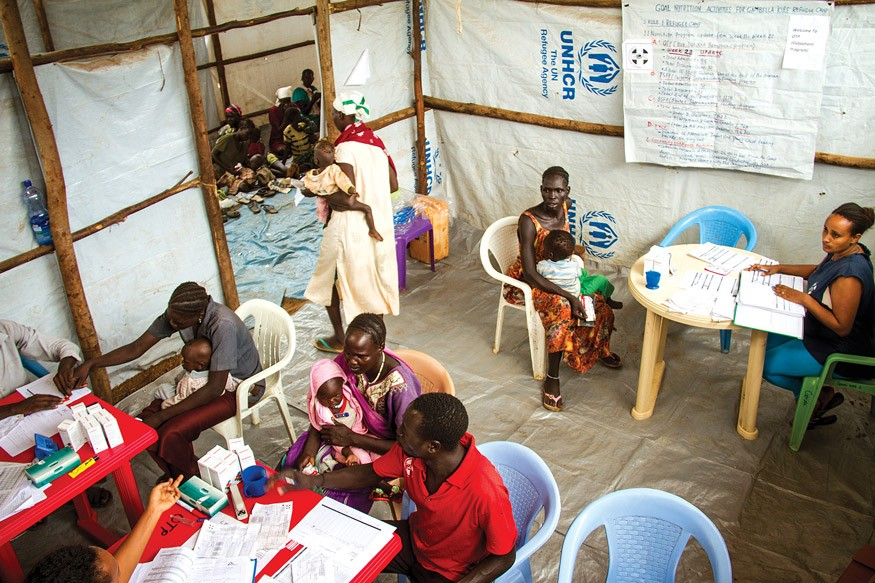 A group of health professionals advise South Sudanese mothers at a treatment center for children suffering from severe acute malnutrition, a life-threatening condition. Photo: UNICEF Ethiopia/2014/Ayene