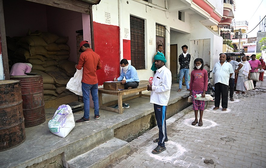 People maintain social distance as they in queue to receive free ration during lockdown in wake of Coronavirus pandemic in Prayagraj, India on Thursday, April 02, 2020. Prabhat Kumar Verma/iStock photo