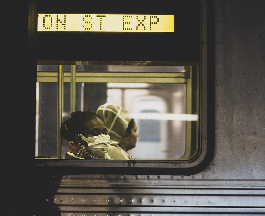 A woman wearing a protective face mask rides the New York City subway during the coronavirus pandemic. Joel Carillet/iStock photo