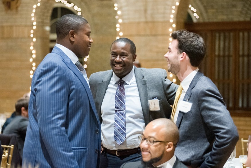 Kelvin Beachum, who until recently was a player for the Pittsburgh Steelers, talks with Eric Mitchell, Bread's director of government relations. Photo: Bread for the World