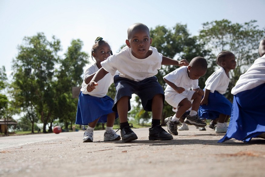 Children at Lott Carey Mission School play outside during P.E. class. Photographer: Laura Elizabeth Pohl