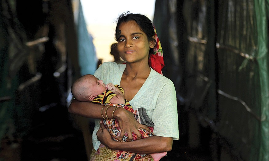 Myanmar displacement camps in Myanmarís Rakhine State. A mother and child at Thea Chaung camp on the outskirts of Sittwe, Rakhine State. UN Photo/OCHA/David Ohana