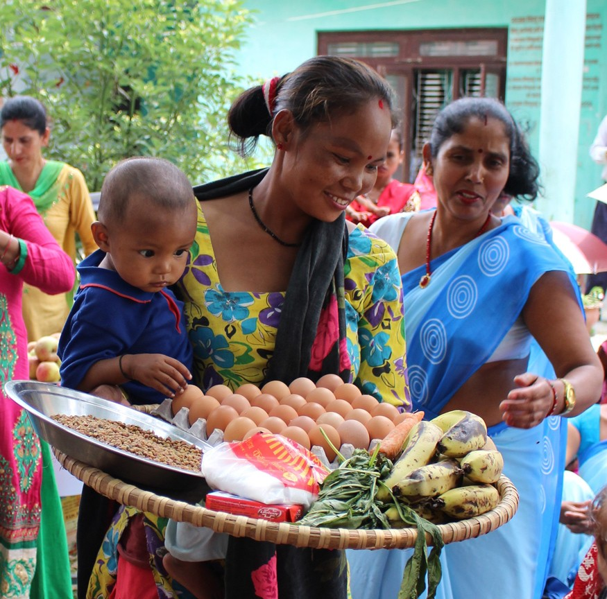 A mother in Nepal receives nutritious foods and soap to improve the nutrition of her children. Photo: : Kesi Marcano-Collier / Bread for the World