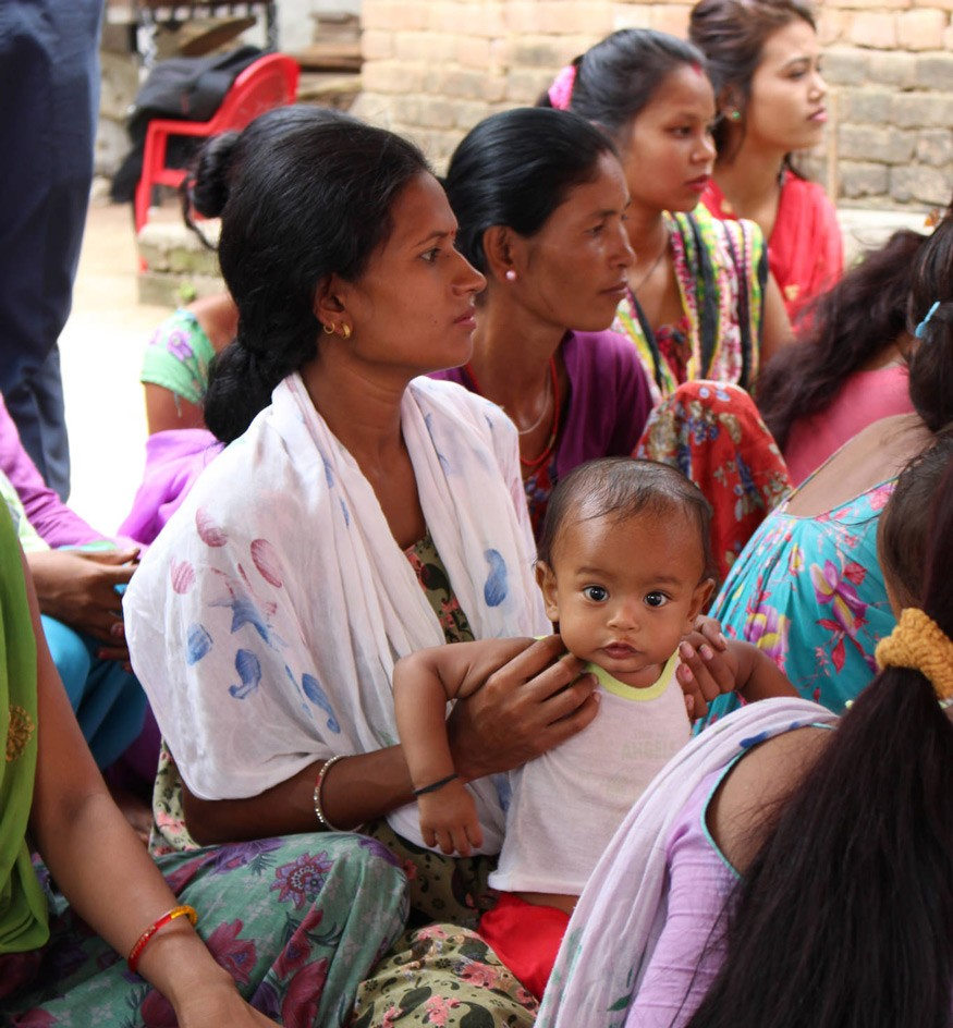 Mothers and their children attend a food demonstration conducted by Female Community Health Volunteers with the Suahaara II Program in Nepal.  Photo by Kesi Marcano-Collier.
