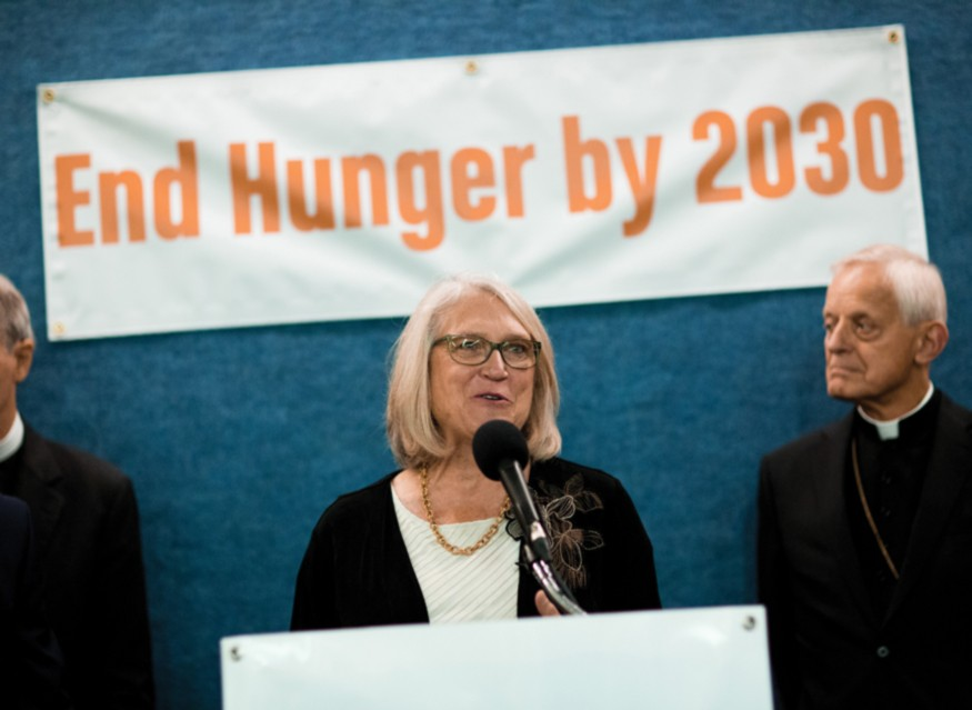 Rev. Dr. Sharon E. Watkins, at the podium, speaking about ending hunger by 2030. Photo: Zach Blum for Bread for the World