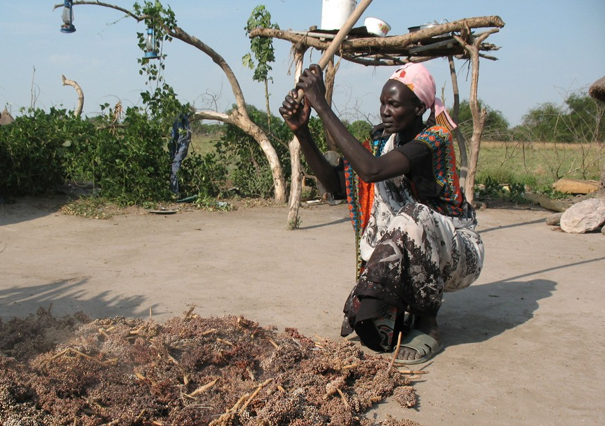 Dabora Nyibol, a returned refugee in South Sudan, prepares sorghum. Photo: Stephen Padre for Bread for the World