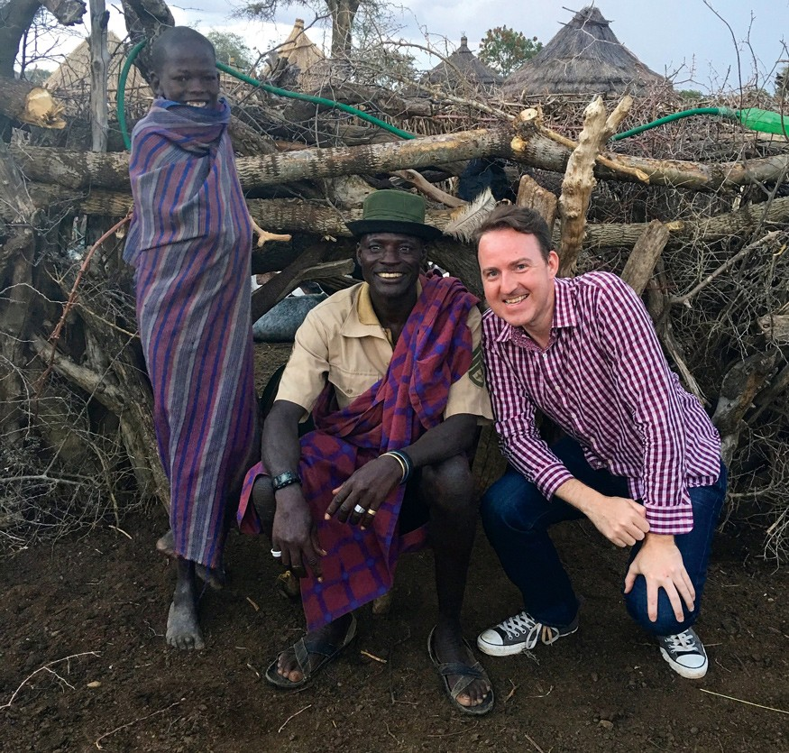 Ugandan farmer Iko Nakol and one of his sons are pictured here with Bread for the World government relations analyst Ryan Quinn.