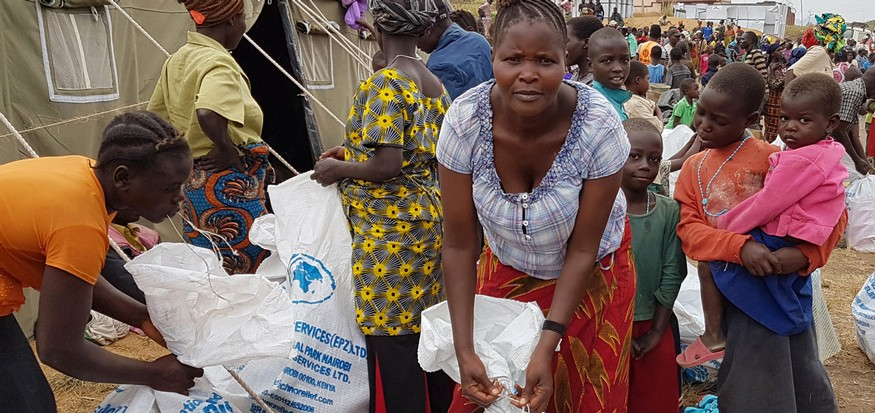 Displaced persons collect relief supplies in Ituri province, north-east DRC. Interethnic violence has ravaged the Ituri Province since December 2017. UNICEF/Madjiangar