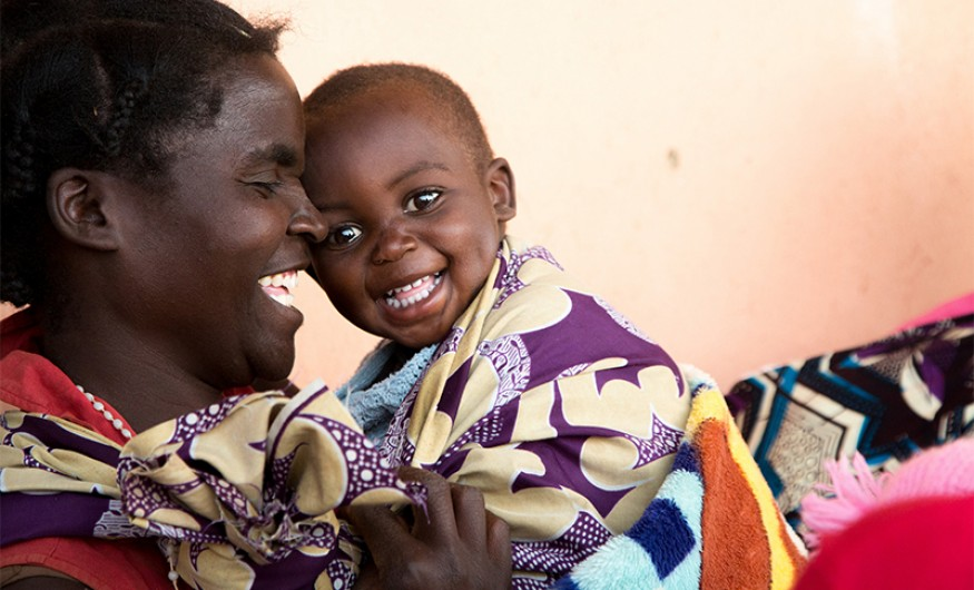 In rural Zambia, Dcsco Muyanda shares a moment of laughter with her son Berty. Photo: Joe Molieri / Bread for the World